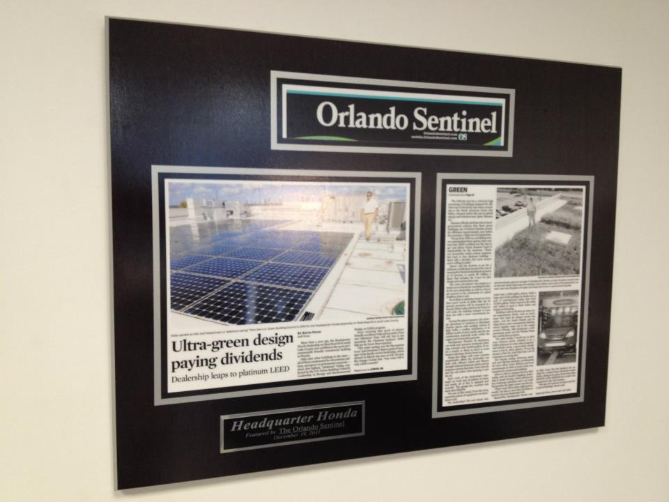featrued article on green initiatives wall display