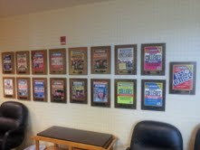 A wall of plaques, a wall of success
