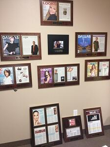 Alan has several walls worth of plaques to showcase his accomplishments and those of his businesses.