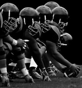 The football team lined up for the upcoming play is an iconic image for football fans all across America.