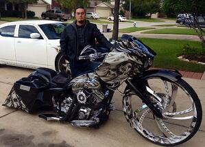 Erik with one of his custom-painted motorcycles.