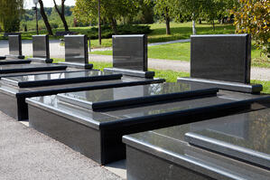A row of unmarked graves.