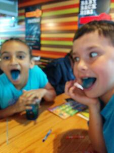 Gail's grandchildren having a contest to see who has the bluest tongue.